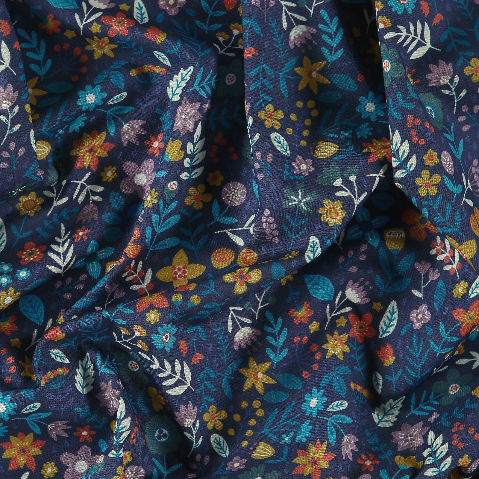 Woven viscose pastel blue with flowers